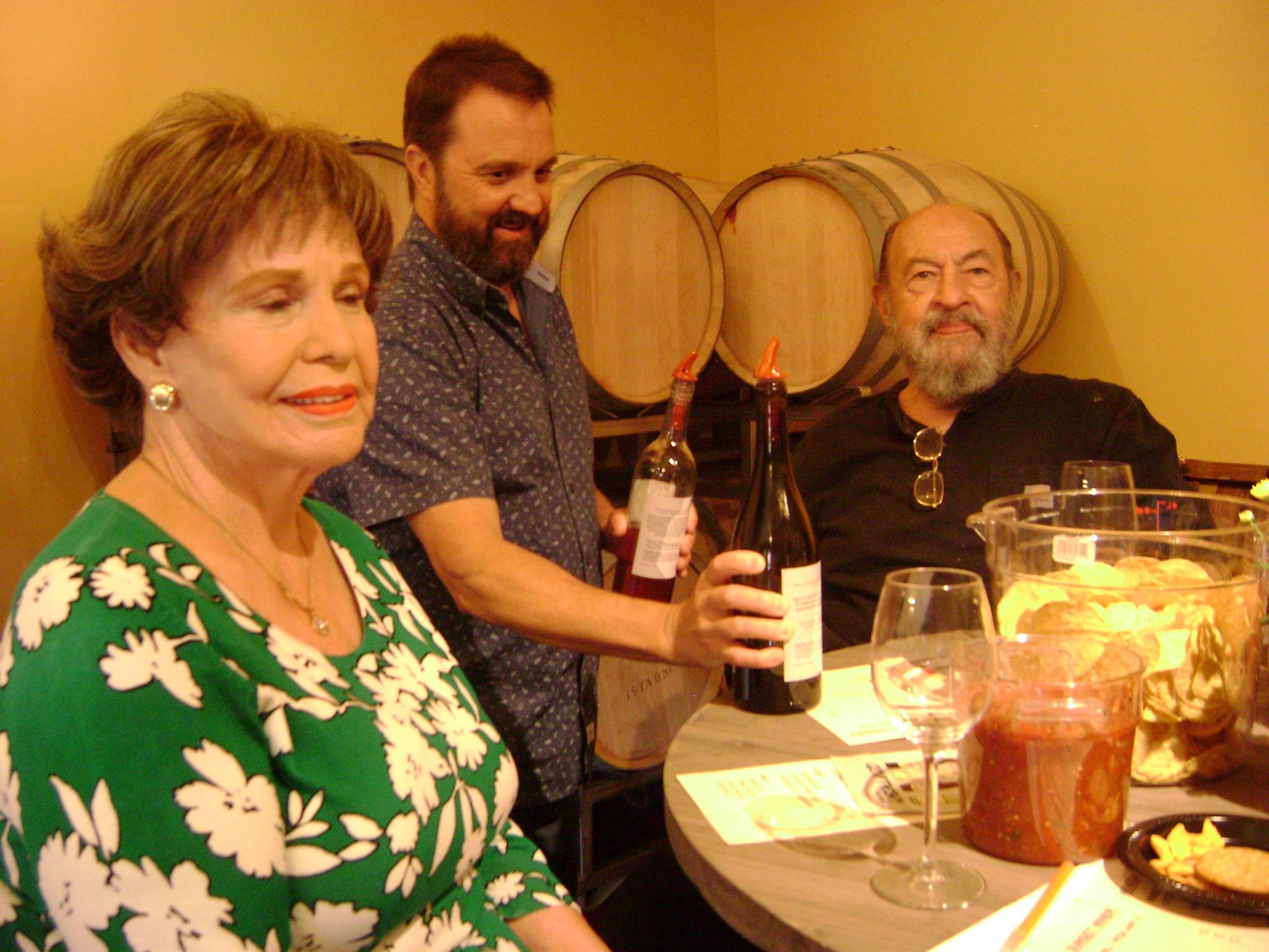 Ron Hershey pours for guests Bill Coplin and friend Grace at the grand opening of Nevada Sunset Winery on September 15. Photo:@GrapeBasinNews
