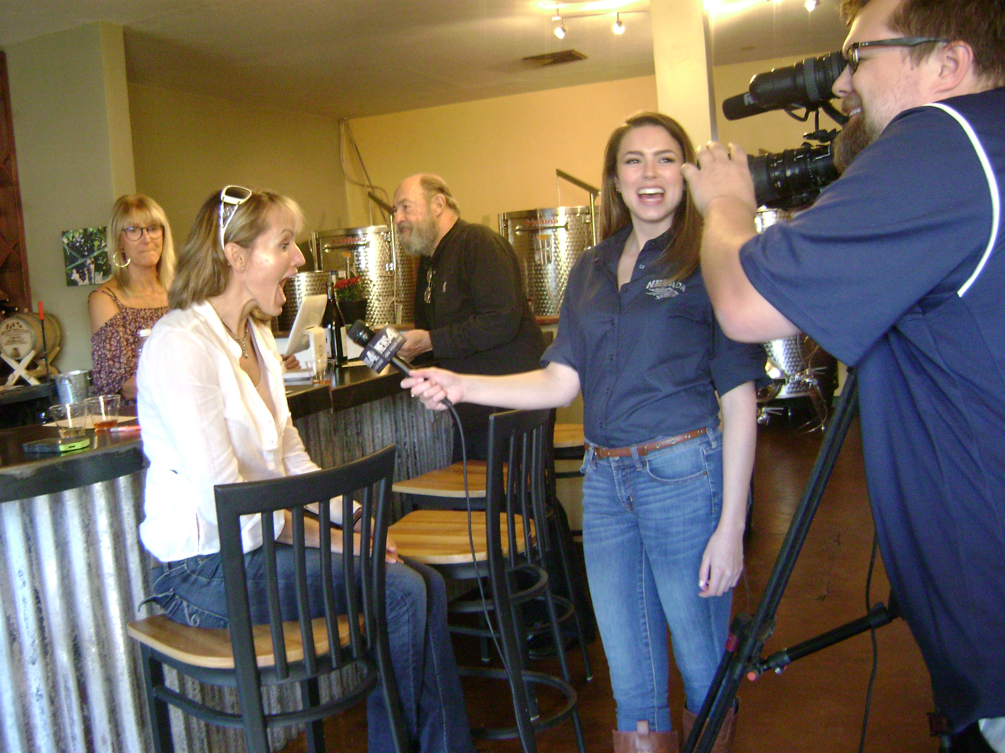 A television crew interviews a patron at the grand opening of Nevada Sunset Winery on September 15. Photo: @GrapeBasinNews